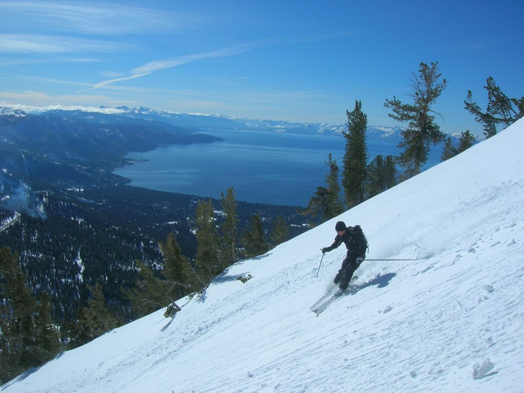 Skiing incline peak with lake tahoe in the background